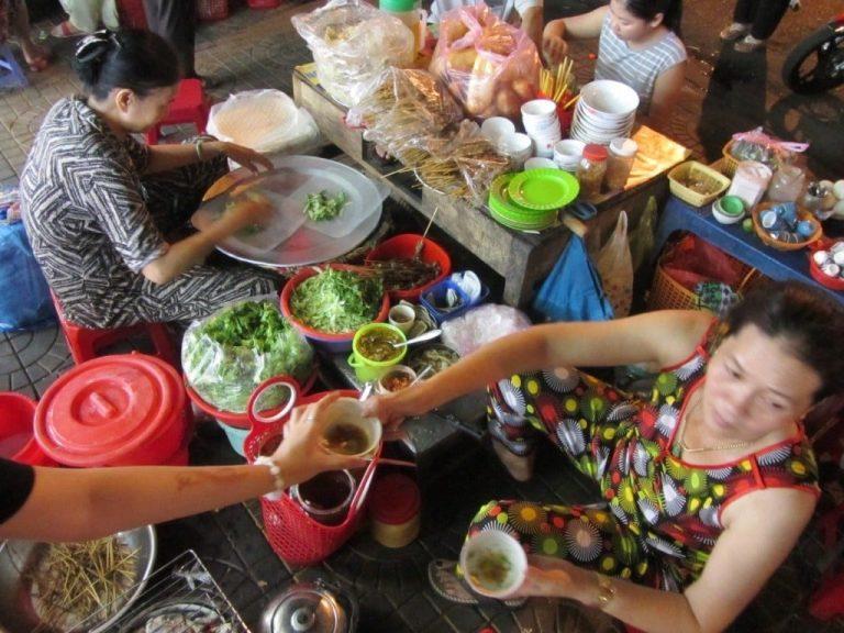 delving into some street food treats at Kon Tum's market