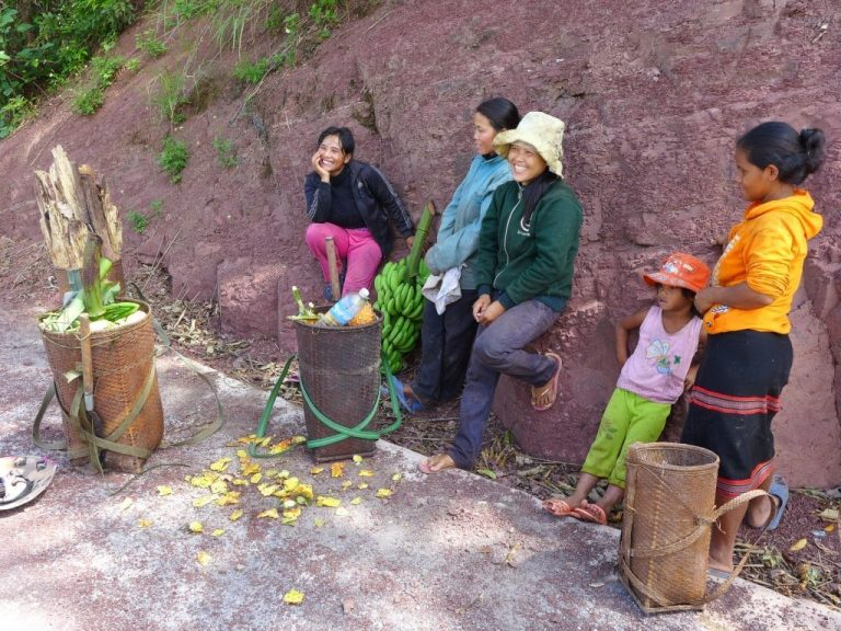local people in the Da Krong Valley chat & laugh while sharing their freshly picked pineapple with us
