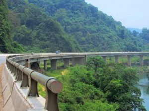 the Ho Chi Minh Road is elevated above jungles & rivers as it passes through Cuc Phuong