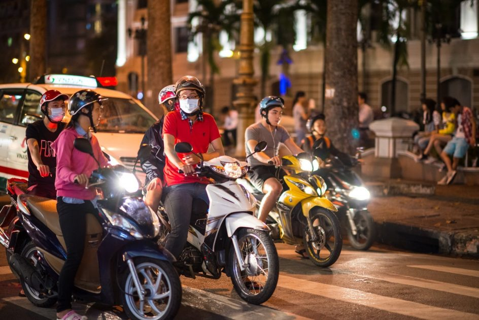 motorcyclists on a busy Vietnam street at night