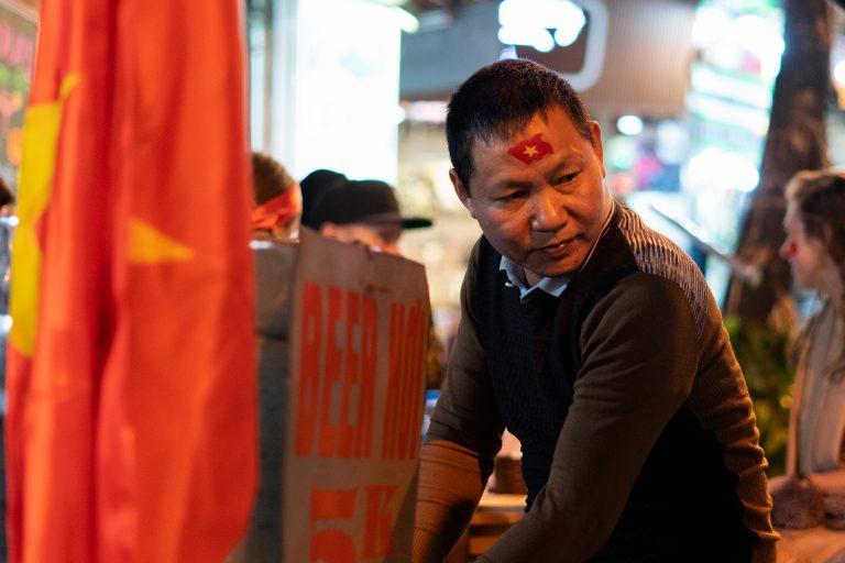 man selling cheap beer in Hanoi's Old Quarter