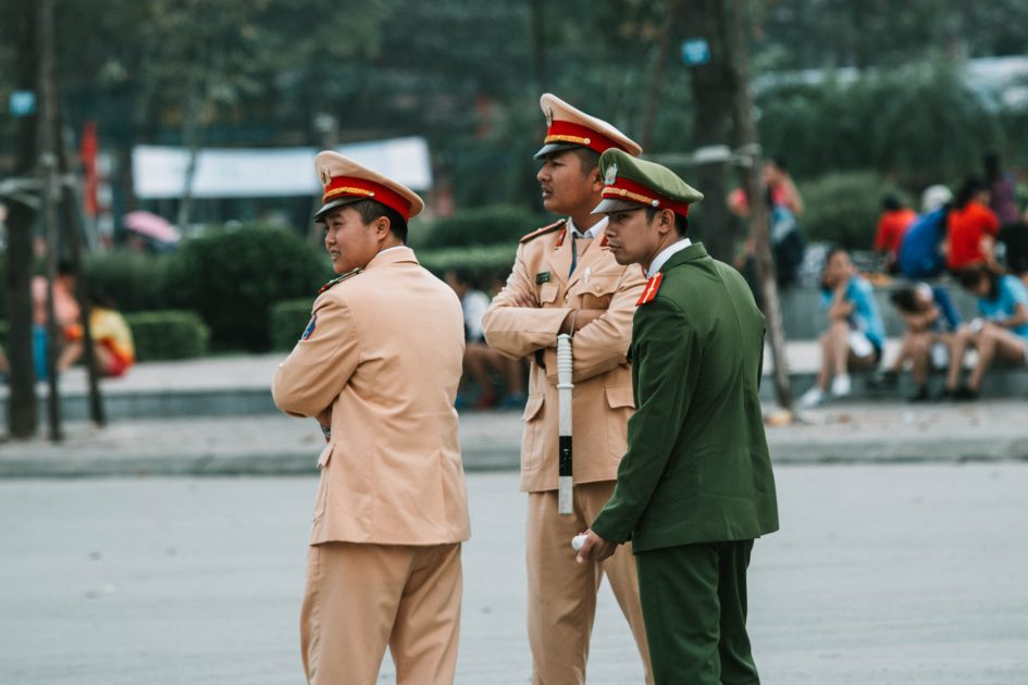 police standing at a busy intersection in North Vietnam