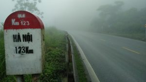a distance marker on the road back to Hanoi