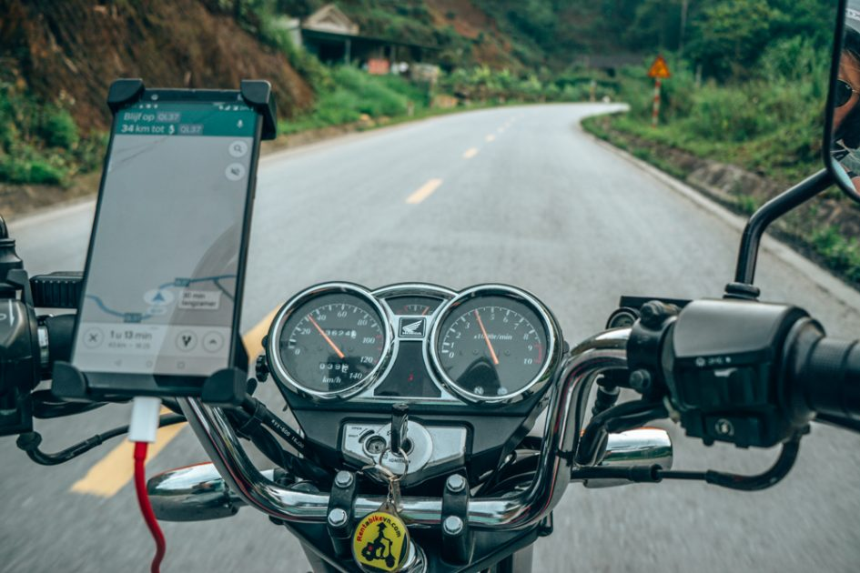 riding a Honda Master on the open road in North Vietnam