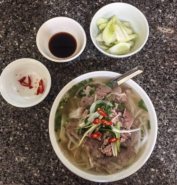 a bowl of pho bo, Vietnamese beef noodle soup