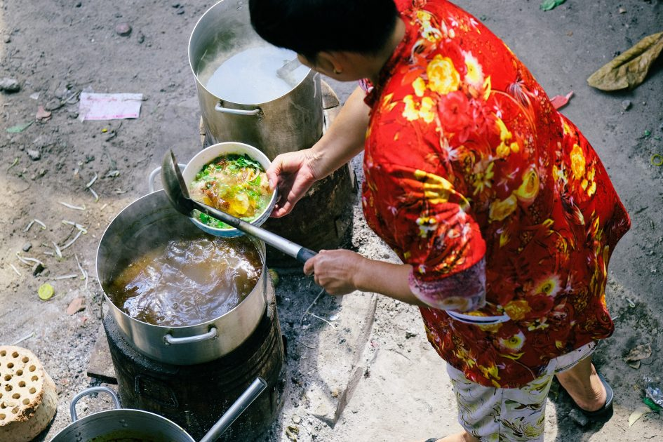 lady preparing food on the street in Vietnam