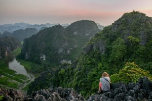 taking photographs from atop a mountain in North Vietnam
