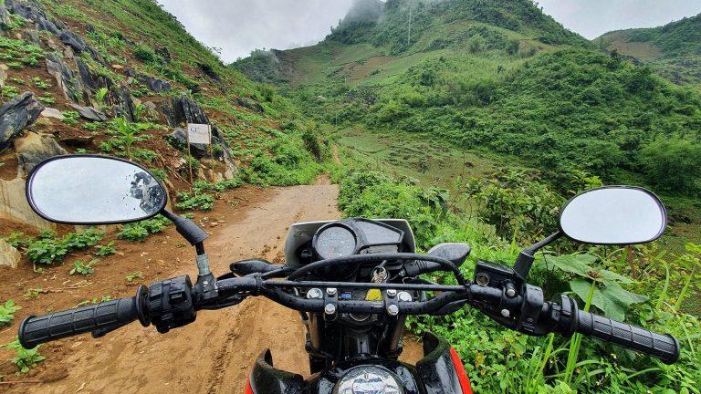 Honda XR 150 handlebars and a Mai Chau dirt road