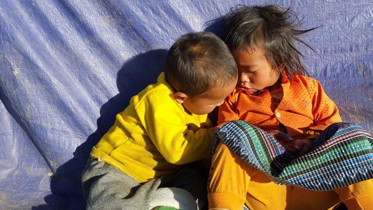 two children relaxing in Ta Xua National Park, North Vietnam