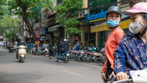two women on a motorbike in Hanoi's Old Quarter