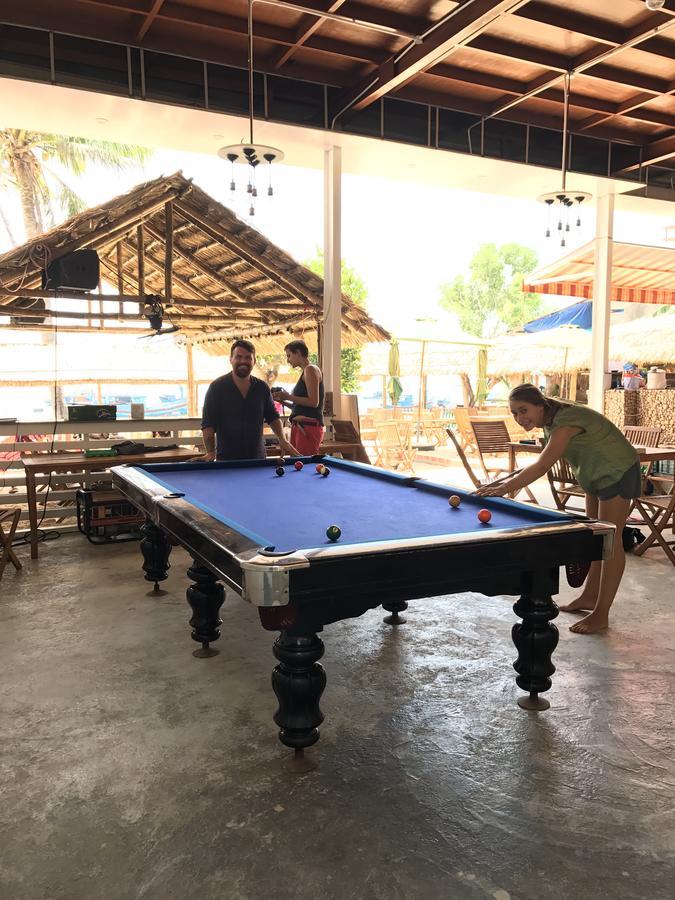 playing pool at the Nhon Hai Beach Hostel
